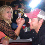 Arm wrestle for who picks up the tab....Justin doesn't look worried