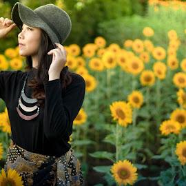 by Faizar Ridwan Rahman - People Portraits of Women ( cool, calm, model, fashion, warm, sunflowers, green, indonesian girl, beautiful, sunflower, nice, yellow, cute, photo, asian, asian girl, girl, woman, indonesia )