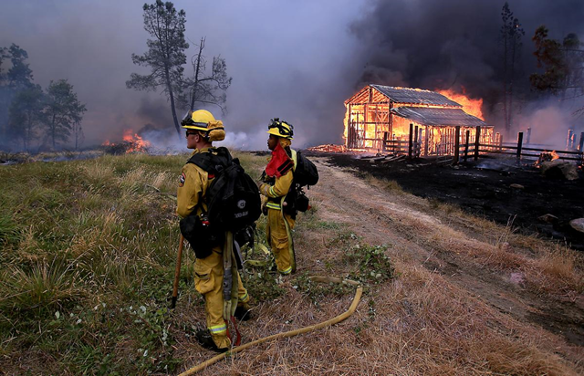 A barn burns in Whispering Pines on Cobb Mountain on Saturday, 12 September 2015. Photo: Kent Porter / AP