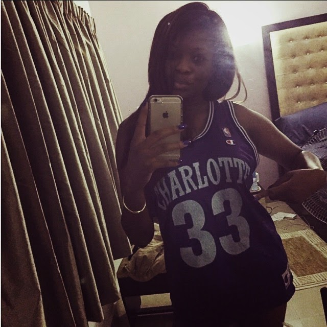 Kemi adetiba decide to show off a jersey she stole from her brother 20years ago in this sexy selfie