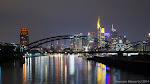 """Skyline of Frankfurt City at night I shot the image while staying on the new bridge in Frankfurt named """"Osthafenbrücke"""". The large house at left side of the picture is one of designed and built by a very famous Austrian architecture F.Hundertwasser."""