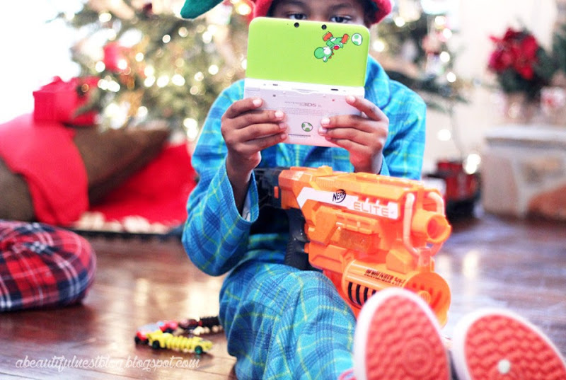 A-Beautiful-Christmas--2014-playing-DS-and-holding-Nerf-OMG