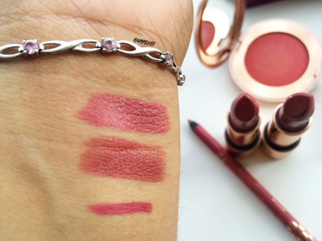 Swatch of kiko intensely lavish lip pencil in 01 lusty peony on medium tan indian nc40 skin