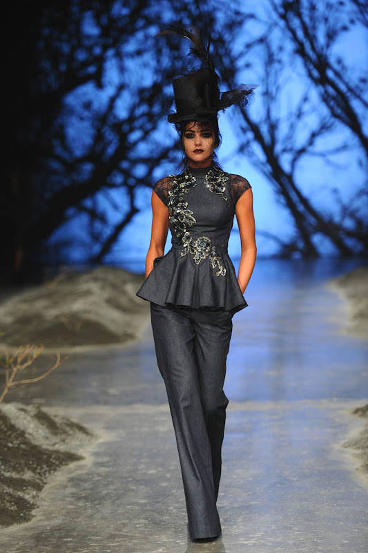 DUBAI, UNITED ARAB EMIRATES - APRIL 12:  A model walks the runway at the Amato by Furne One show during Dubai Fashion Forward April 2015 at Madinat Jumeirah on April 12, 2015 in Dubai, United Arab Emirates.  (Photo by Stuart C. Wilson/Getty Images for Fashion Forward)