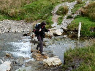 Jill negotiates the easy stepping stones.