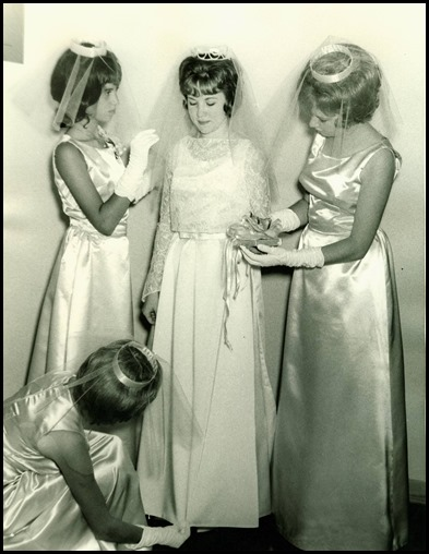 Attendants Assist Bride
