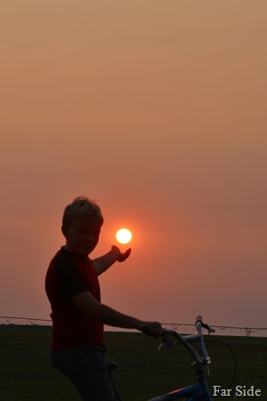 Mason holding the sun