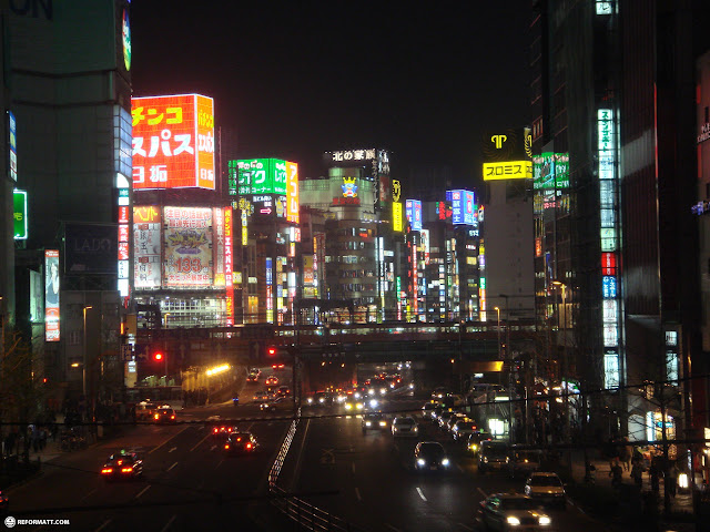 the famous view of Yasukuni dori at night with lots of neon lights in Shinjuku, Tokyo, Japan