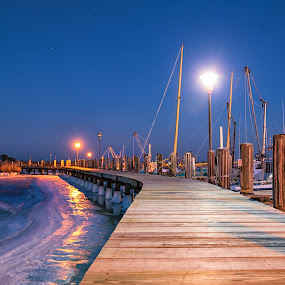 Winter at the Dock by Carol Ward - Landscapes Waterscapes ( winter, elliotts island, waterscape, boats, frozen waterway, maryland, frozen, landscape, frozen river, dusk, dock, mccreadys point )