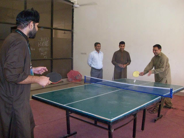HOD and Sir Naeem playing while sir javed is watching