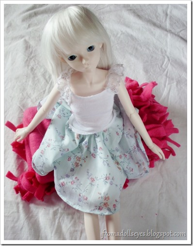 Doll Sitting on Folded Fleece Blanket