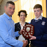 Shaun McFadden, and Fiona Temple presenting Eoin McGonigle with the Junior Sports Student of the Year Award at the Mulroy College Junior Prize Giving.   Photo:- Clive Wasson