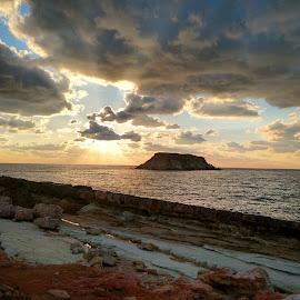 St. George Island  by Anastasis Agathokleous - Landscapes Waterscapes ( waves, blue sky, seascape, sunlight, blue, rocks, island, sunset, clouds, sea,  )