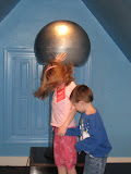 Hannah and Bryan getting staticky hair at the Magic House in St Louis 03202011a