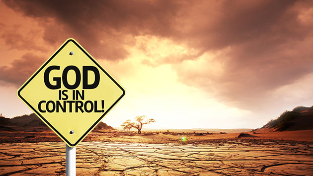 A sign reads 'God is in control!', before a scene showing a dessicated wasteland caused by drought. Photoshop: Ben Dreyfuss; Backrgound: Galyna Andrushko/Shutterstock; Sign: Gustavo Frazao/Shutterstock. Graphic: Mother Jones