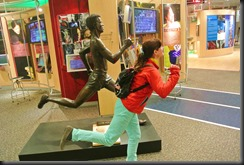 Cheryl remains competitive....even against the Statues.
