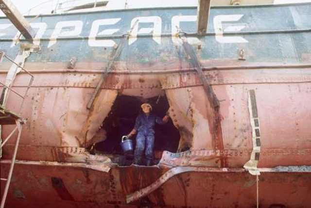The bombed hull of the Greenpeace flagship 'Rainbow Warrior', following its sabotage by the French secret service is shown in Auckland port on 1 August 1985. Photo: Fournis / AFP