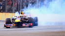 Sebastian Vettel makes some donuts with his Red Bull RB9