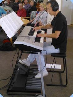 Taka Iida playing his Yamaha Electone D-Deck keyboard.