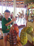 Bryan riding on the carousel at the Nashville Zoo 09032011b