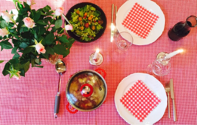 Dinner table with reindeer gnocchi and a green salad