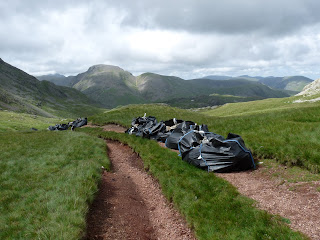 Sacks of Stones on path from Esk Hause to Sprinkling Tarn