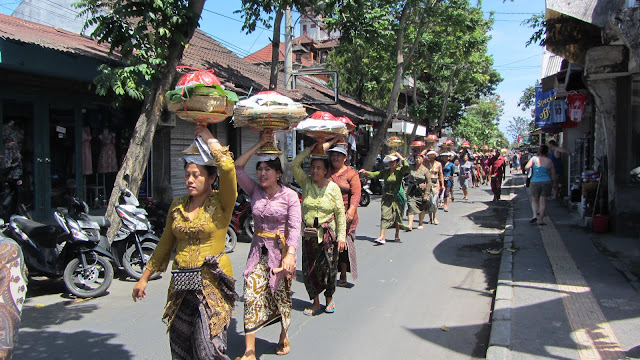 A traditional procession through the touristy streets and alleyways of Kuta.