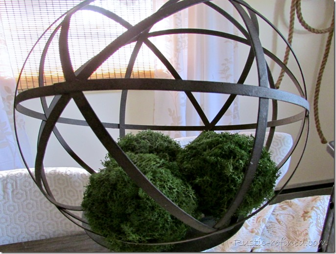 Using wrought iron orbs as a table centerpiece