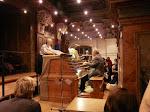 Gundi explains while Professor Metzger plays the organ