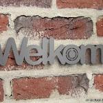 inox-deurbel-welkom-muur.jpg