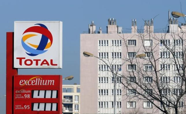 A logo is pictured at French oil and gas company Total gas station in Marseille, 11 February 2015. Photo: Jean-Paul Pelissier / Reuters