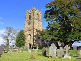 Ellastone Church of St. Peter's dates back to the 16th century with the year 1586 displayed on the tower.