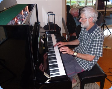 Errol Storey playing the Wertheim piano. Photo courtesy of Delyse Whorwood.