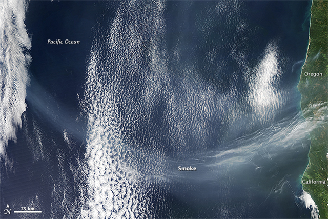 In a reminder of the interconnectedenss of our atmosphere, smoke that originated in Siberia had reached the West Coast of North America when the Moderate Resolution Imaging Spectroradiometer (MODIS) captured this image on April 18, 2015. The smoke likely came from wildfires burning in the steppe of southern Russia. Photo:  Jeff Schmaltz / LANCE/EOSDIS MODIS Rapid Response Team at NASA GSFC