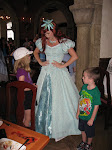 Bryan listening while Aeriel talks to Hannah at the Akershus restaurant in Norway in Epcot 06072011b