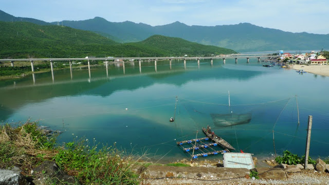 Top Gear fans: imagine this scene at sunset, and with Clarkson waxing lyrical over how the modern bridge and the old-fashioned boats sum up Vietnam for him. Look familiar? =)