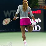 Serena Williams stretches after a brief slip on court