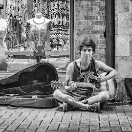 Street Song by Paul Frese - People Street & Candids ( music, urban, song, black and white, street, texas, teenager, san antonio, artistic, guitar )