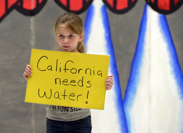 Neveah Craft, a third grader in Capistrano elementary school's after school program, holds a sign about the drought during a rehearsal in their talent show Monday, 4 May 2015 in Modesto, Calif. The kids at Capistrano participated in a drought awareness presentation, to learn about how the drought is affecting California. Photo: Joan Barnett Lee / Associated Press