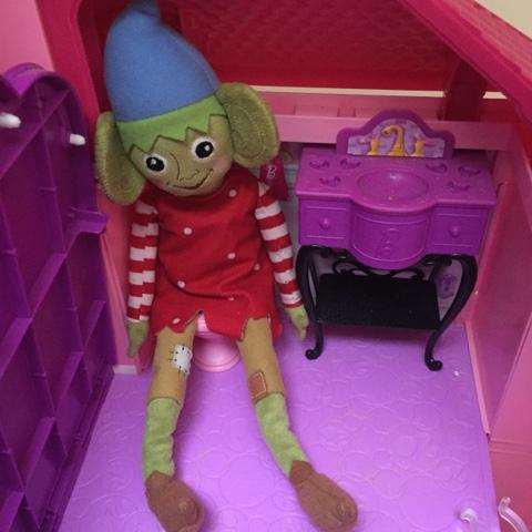 elf on barbie toilet