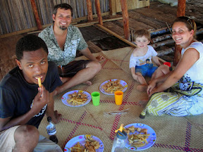 A Malagasy YWAM co-worker accompanied our US friend, Linda, to visit us on Nosy Mitsio. Here we're eating a great meal of fried fish and French fries inside our house before it was finished.