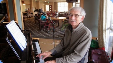 Claude Moffat playing the Kawai mini-grand. Photo courtesy of Dennis Lyons.