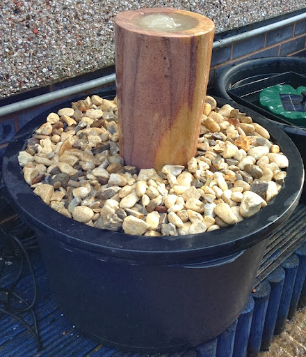This is a great example of how you can set up your own water feature. Here we've used a pebble pool which is complete with a lid, a Bermuda 770 feature pump, one bag of gravel and an Indian Rainbow Stone water feature. All of this for just £124.99 and you can site it wherever you like, you could sink the sump into the ground or keep it above ground. It's easy to keep clean too, just use a pack of Bermuda Pebble Pool Fresh.<br /><br />Come and see us at our Sutton Coldfield Branch, address below or visit us online at www.gardensite.co.uk<br /><br />Hall's Aquatic Superstore, 211 Chester Road, Sutton Coldfield, B73 5BD. FREE Car parking on site and The Garden Room Coffee Shop.