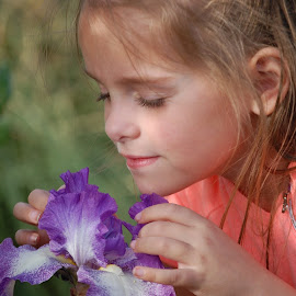 smelling the iris by Cathy Henson - Babies & Children Child Portraits ( child, summer, iris, light, soft,  )