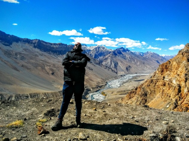 Photo pit stop with the surreal Spiti valley in the background