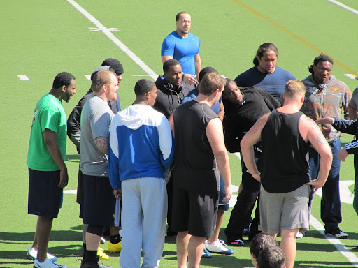 Jahvid Best in the middle with headphones. Wonder what he listens to. Brian Holley is at top in the blue shirt. Verran Tucker is wearing the blue and white hoodie. Erik Robertson to Verran's left. To his right is Mike Tepper and to the right of Tepper is Kevin Bemoll.