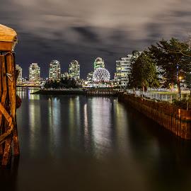 Vancouver Vista by Cory Bohnenkamp - City,  Street & Park  Vistas ( water, skyline, false creek, vista, night, pilings, science world, vancouver, city )