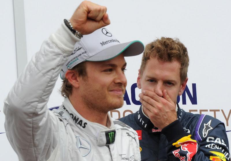 радующийся Нико Росберг и фэйспалмящий Себастьян Феттель после квалификации на Гран-при Монако 2013