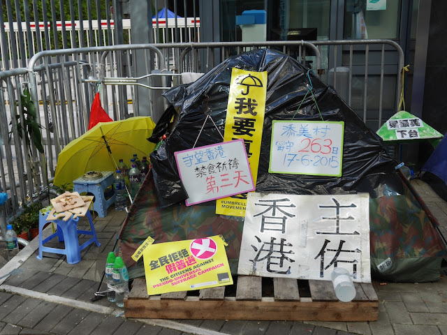a tent with Umbrella Movement signs