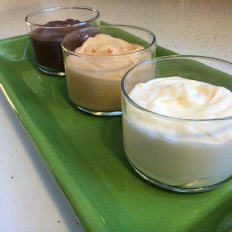 chocolate fudge, butterscotch, and white chocolate budino in dessert cups
